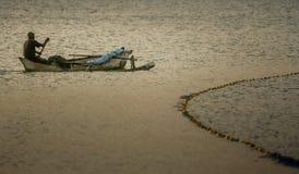 独木舟的人 库存照片