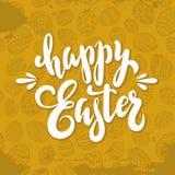独特的手写的字法在金背景w的复活节快乐 免版税库存照片