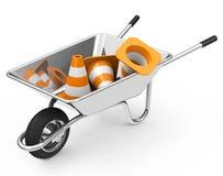 独轮车和锥体 免版税库存照片