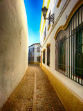 狭窄朗达,安达卢西亚西班牙被修补的街道  库存图片