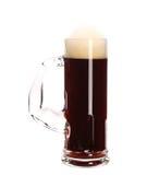 狭窄的杯子棕色啤酒。 免版税库存照片