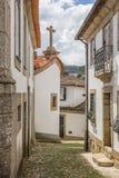 狭窄的铺有鹅卵石的街道在历史镇Amarante 图库摄影