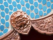 狮子在中国式装饰的面孔标志 库存图片