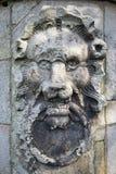 狮子头石雕塑  免版税图库摄影