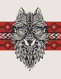 狼的种族图腾 印地安狼 一头狼的纹身花刺与装饰品的 手拉的向量例证 免版税库存图片