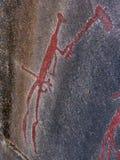 猎人。 岩石雕刻 库存照片