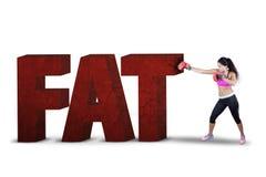 猛击与拳击手套的妇女肥胖文本 库存照片