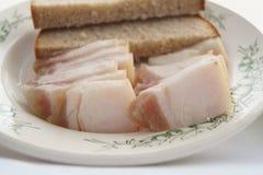 猪油和面包在板材 库存图片