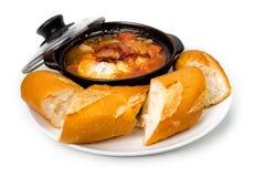 猪肉炖用鸡蛋和面包 库存照片