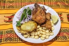猪肉盘,典型的秘鲁晚餐 免版税库存照片