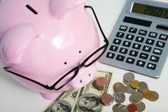 猪银行和计算器 免版税库存照片