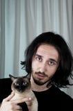 猫人藏品sieamse年轻人 免版税库存图片