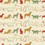 猫和狗剪影的动物无缝的传染媒介样式 免版税库存照片