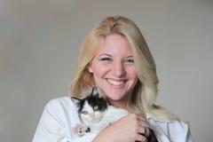 猫微笑的妇女 库存照片