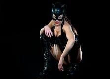 猫服装的妇女 免版税库存照片