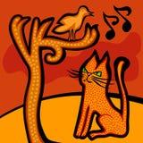 猫观看一只唱歌鸟 库存图片