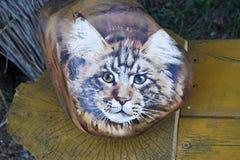 猫,绘在岩石 免版税库存图片