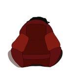 猫延长在椅子和闪动的眼睛背面 免版税图库摄影