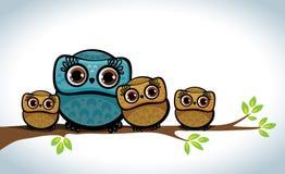 猫头鹰家庭。 免版税库存图片