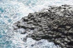 玄武岩柱状联合海岸在JungMun 免版税库存照片