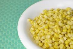 玉米五谷在蓝色桌布的 库存照片