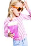 玉米吃女孩流行音乐 免版税库存照片