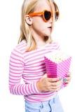 玉米吃女孩流行音乐 库存图片