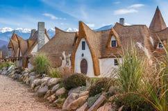 玉米棒和黏土房子 免版税库存照片