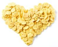 玉米片被安排以心脏的形式 免版税库存照片