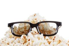 玉米花,玻璃的微笑的妖怪 查出在白色 免版税库存图片