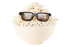 玉米花,玻璃的正面微笑的妖怪 查出在白色 免版税库存照片