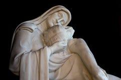 玛丹娜和基督雕象  库存照片