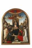 玛丹娜和孩子王位的由两个天使加冠了,与圣父和圣徒 库存图片