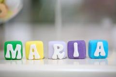 玛丽亚名牌由可食的蛋糕制成 图库摄影