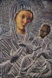玛丽和耶稣银色图标  免版税库存图片
