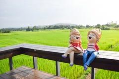 玩偶坐木 免版税图库摄影
