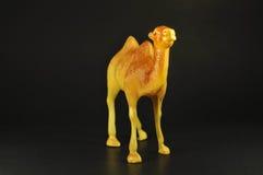 玩具在黑色的骆驼褐色 免版税库存图片