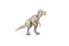 玩具恐龙缩样在白色背景的 免版税库存照片