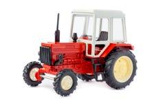 玩具拖拉机被隔绝的模型 免版税库存照片