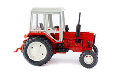 玩具拖拉机被隔绝的模型 免版税库存图片