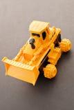 玩具推土机 图库摄影