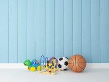 玩具有蓝色木背景 免版税库存照片