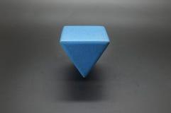 玩具木蓝色三角块 库存图片