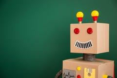 玩具机器人在学校 免版税库存照片