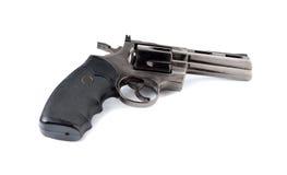 玩具枪357在白色的大酒瓶左轮手枪 免版税库存图片