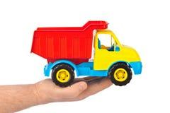玩具汽车卡车在手中 库存图片