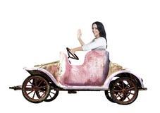 玩具汽车的妇女 库存图片