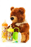 玩具熊和乳瓶和安慰者孩子的 图库摄影