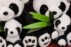 玩具熊猫和叶子 库存照片