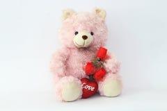 玩具熊,桃红色和英国兰开斯特家族族徽 库存图片